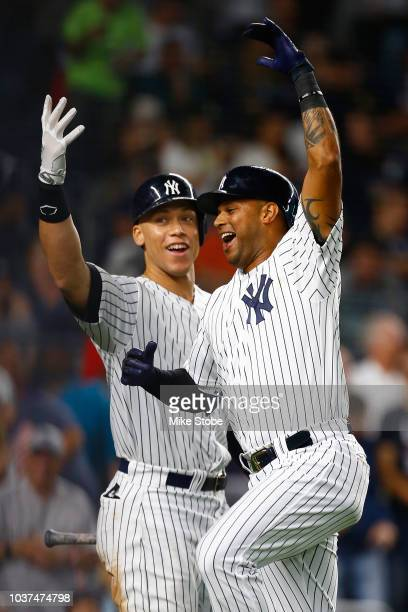 Aaron Hicks of the New York Yankees celebrates with Aaron Judge after hitting a 2run home run in the fourth inning against the Baltimore Orioles at...