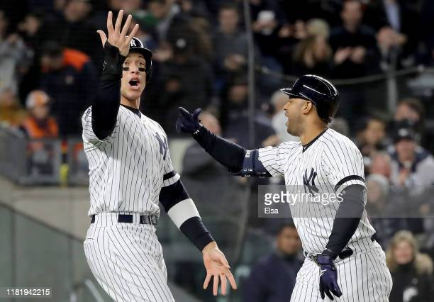 Aaron Hicks of the New York Yankees celebrates with Aaron Judge after hitting a three run home run against Justin Verlander of the Houston Astros...