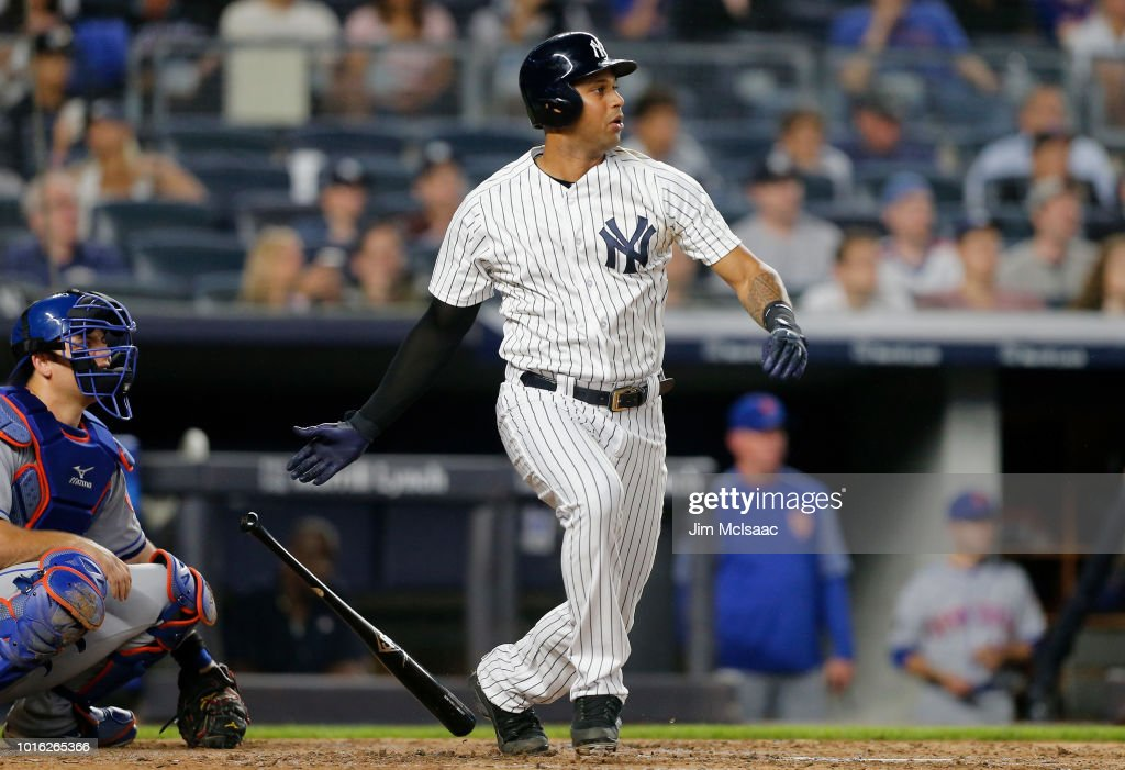 Aaron Hicks #31 of the New York Yankees follows through on a third inning RBI single against the New York Mets at Yankee Stadium on August 13, 2018 in the Bronx borough of New York City.