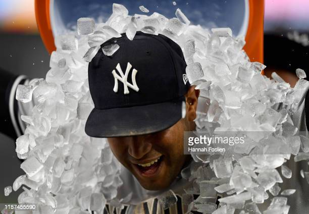 Aaron Hicks of the New York Yankees has ice poured on him after defeating the Minnesota Twins in the game on July 23 2019 at Target Field in...