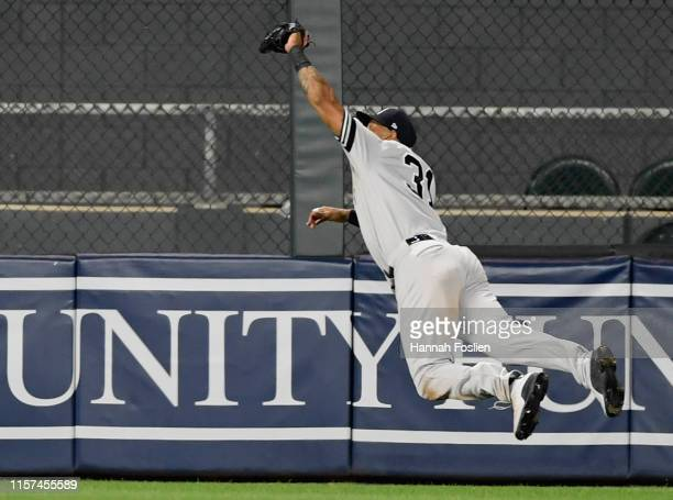 Aaron Hicks of the New York Yankees makes a catch in center field of the ball hit by Max Kepler of the Minnesota Twins during the tenth inning to end...