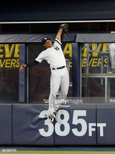 Aaron Hicks of the New York Yankees makes a catch robbing Wilson Ramos of the Tampa Bay Rays of a grand slam home run during the first inning at...