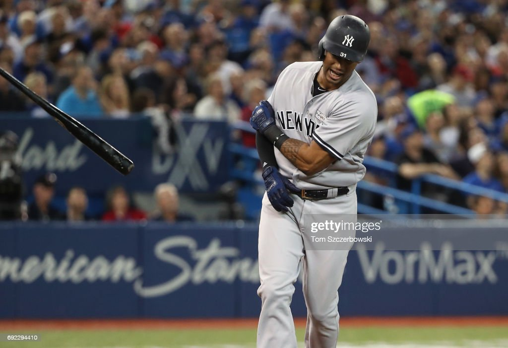 Aaron Hicks #31 of the New York Yankees reacts after popping out to end the fourth inning during MLB game action against the Toronto Blue Jays at Rogers Centre on June 4, 2017 in Toronto, Canada.