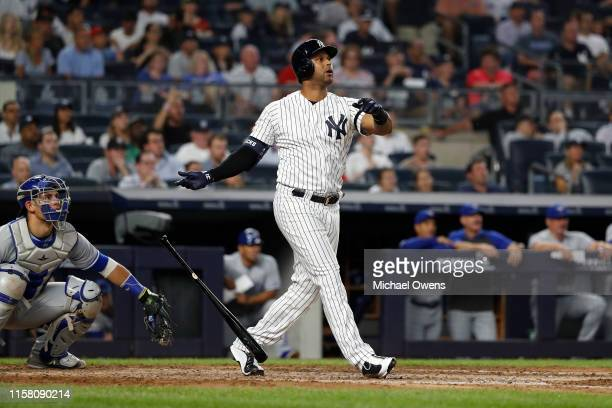 Aaron Hicks of the New York Yankees reacts as he hits a three run home run against the Toronto Blue Jays in the fifth inning at Yankee Stadium on...
