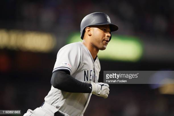 Aaron Hicks of the New York Yankees rounds the bases after hitting a home run against the Minnesota Twins during the game on July 23 2019 at Target...