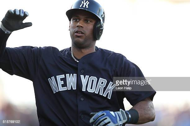 Aaron Hicks of the New York Yankees rounds the bases after hitting a solo home run in the third inning of the Spring Training Game on March 15 2016...
