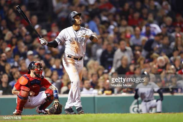 Aaron Hicks of the New York Yankees watches his three run home run during the fourth inning against the Boston Red Sox at Fenway Park on September 28...
