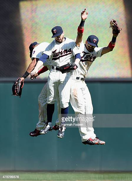 Aaron Hicks Shane Robinson and Eddie Rosario of the Minnesota Twins celebrate a win against the Toronto Blue Jays on May 30 2015 at Target Field in...