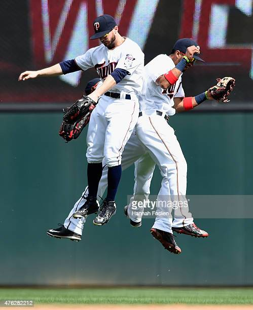 Aaron Hicks Shane Robinson and Eddie Rosario of the Minnesota Twins celebrate a win of the game against the Milwaukee Brewers on June 7 2015 at...
