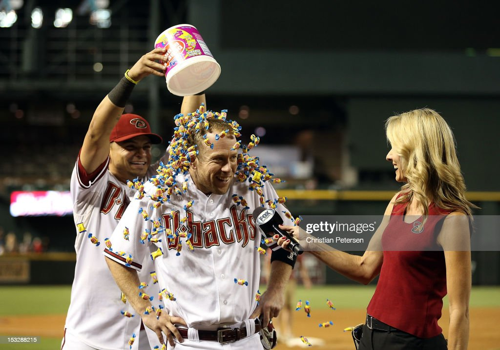 Aaron Hill #2 of the Arizona Diamondbacks is covered in bubble gum by Gerardo Parra #8 as he receives his post game interview from television personality Jody Jackson. Hill hit a walk off three-run home run against the Colorado Rockies during the MLB game at Chase Field on October 2, 2012 in Phoenix, Arizona. The Diamondbacks defeated the Rockies 5-3.