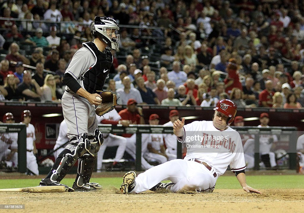 Aaron Hill #2 of the Arizona Diamondbacks is forced out at home plate by catcher Jordan Pacheco #58 of the Colorado Rockies during the sixth inning of the MLB game at Chase Field on April 29, 2014 in Phoenix, Arizona. The Rockies defeated the Diamondbacks 5-4.