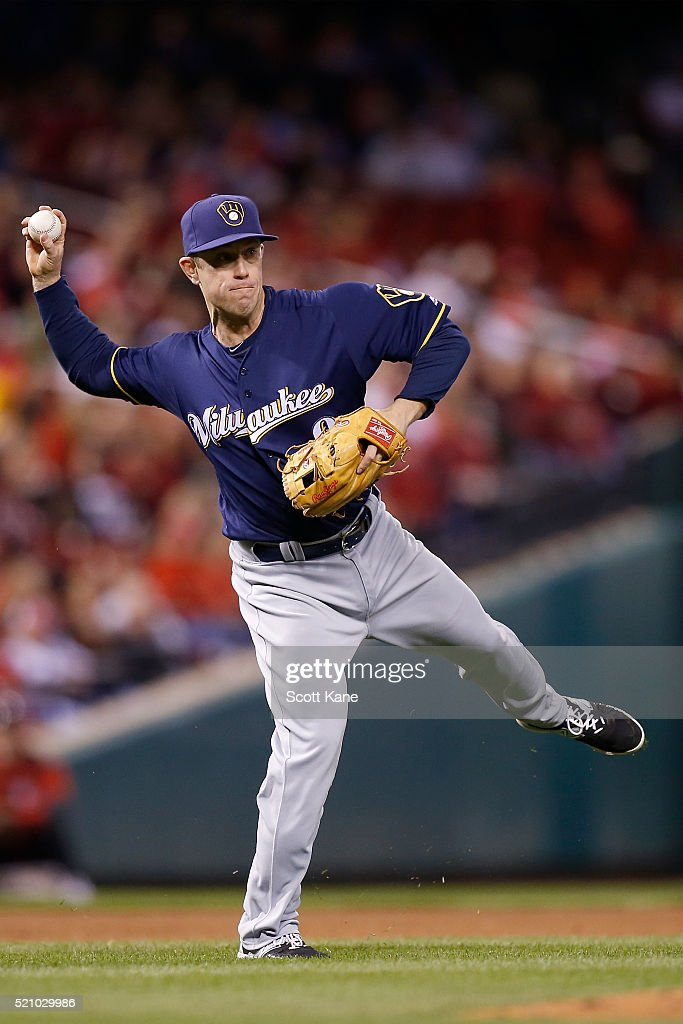 Aaron Hill #9 of the Milwaukee Brewers throws to first for an out to end the in the eighth inning of a baseball game against the St. Louis Cardinals at Busch Stadium on April 13, 2016 in St. Louis, Missouri.