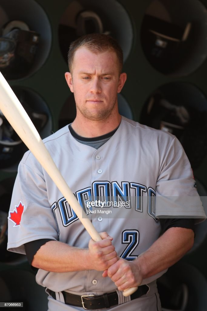 Aaron Hill #2 of the Toronto Blue Jays gets ready in the dugout before the game against the Oakland Athletics at the Oakland-Alameda County Coliseum on May 9, 2009 in Oakland, California.