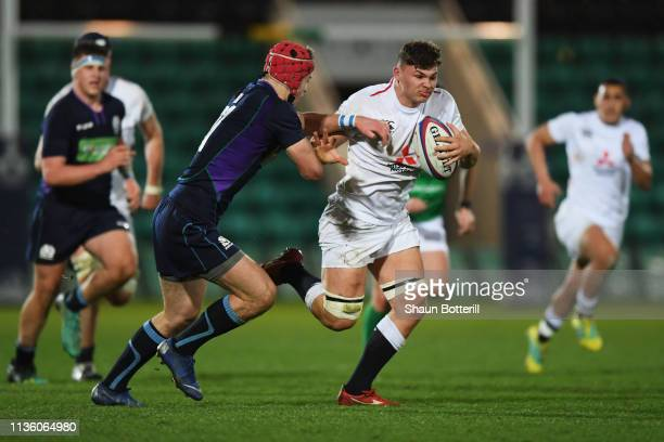 Aaron Hinkley of England gets past the tackle from Jack Blain of Scotland during the Under 20 Six Nations match between England U20 and Scotland U20...