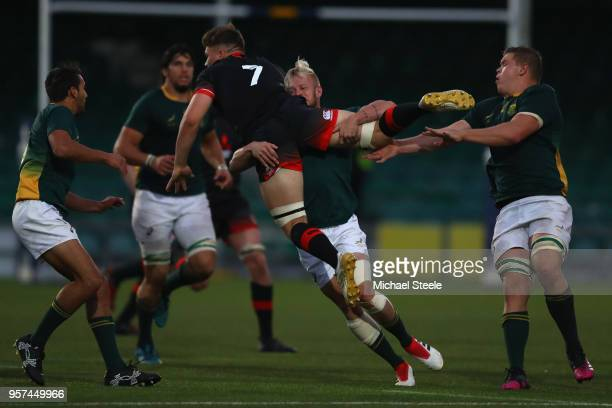 Aaron Hinkley of England is lifted off the ground as Tyrone Green of South Africa makes a tackle during the International match between England U20's...
