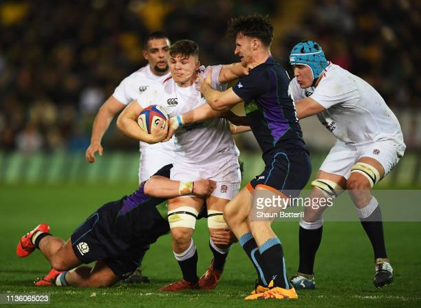 Aaron Hinkley of England is tackled by Rory McMichael of Scotland during the Under 20 Six Nations match between England U20 and Scotland U20 at...