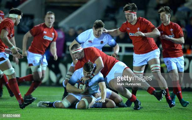 Aaron Hinkley of England is tackled by Sam Wainwright of wales in the second half during the RBS Under 20's Six Nations match between England U20 and...