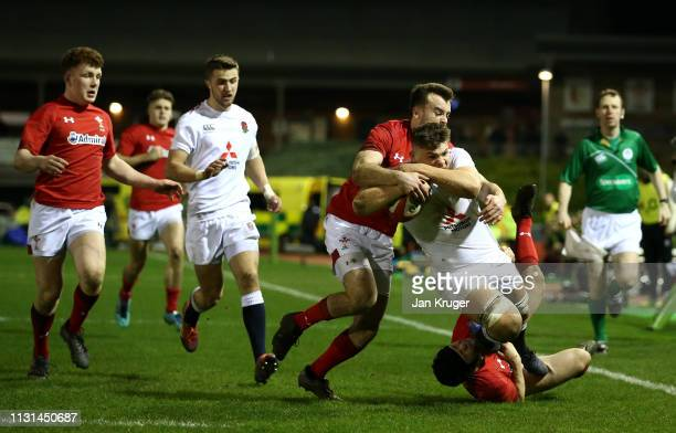 Aaron Hinkley of England is tackled short of the line Cai Evans of Wales and Ioan Davies of Wales during the Wales U20 v England U20 match in the...