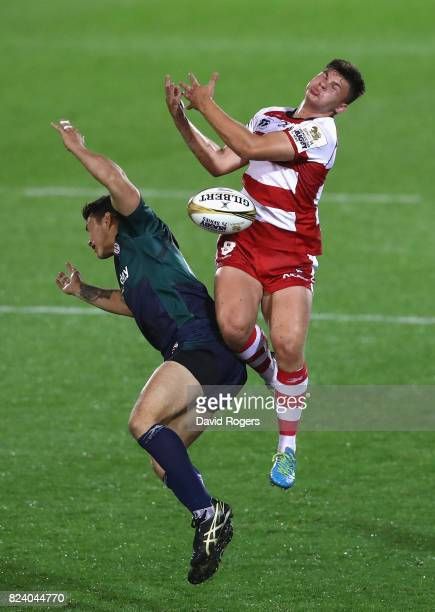 Aaron Hinkley of Gloucester outjumps Dan Barnes of London Irish during the Singha Premiership Rugby 7s Series Day One at Franklin's Gardens on July...