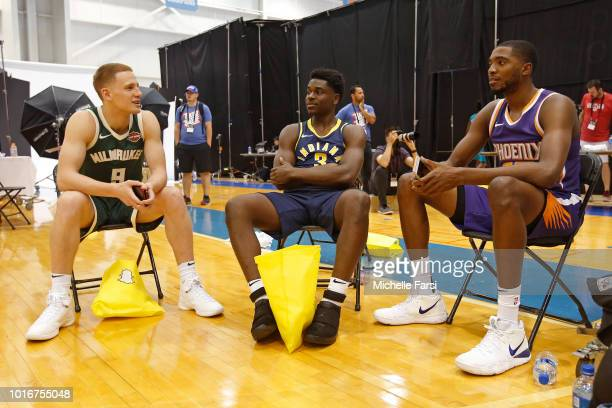 Aaron Holiday of the Indiana Pacers Mikal Bridges of the Phoenix Suns and Donte DiVincenzo of the Milwaukee Bucks talk during the 2018 NBA Rookie...