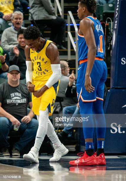 Aaron Holiday of the Indiana Pacers reacts after he scores a basket during the first half of the game against the New York Knicks at Bankers Life...