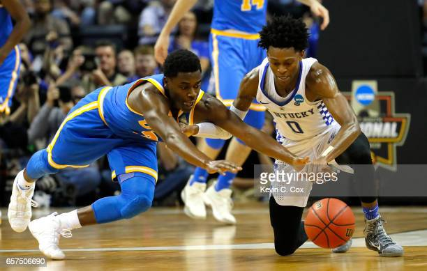 Aaron Holiday of the UCLA Bruins and De'Aaron Fox of the Kentucky Wildcats compete for a loose ball in the second half during the 2017 NCAA Men's...