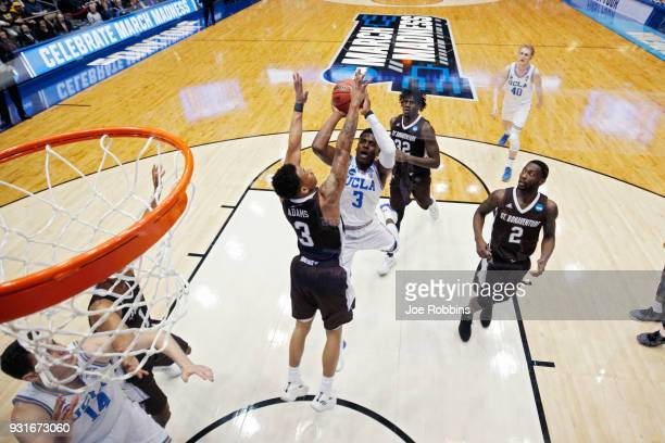 Aaron Holiday of the UCLA Bruins drives to the basket against Jaylen Adams of the St Bonaventure Bonnies in the first half of a First Four game in...