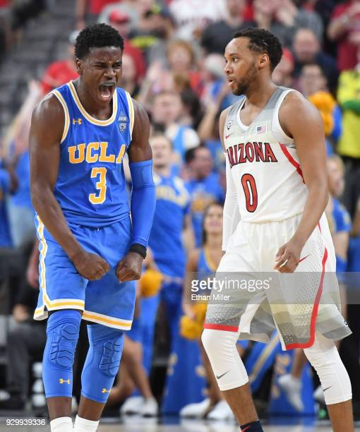 Aaron Holiday of the UCLA Bruins reacts after hitting a 3pointer as Parker JacksonCartwright of the Arizona Wildcats looks on during a semifinal game...