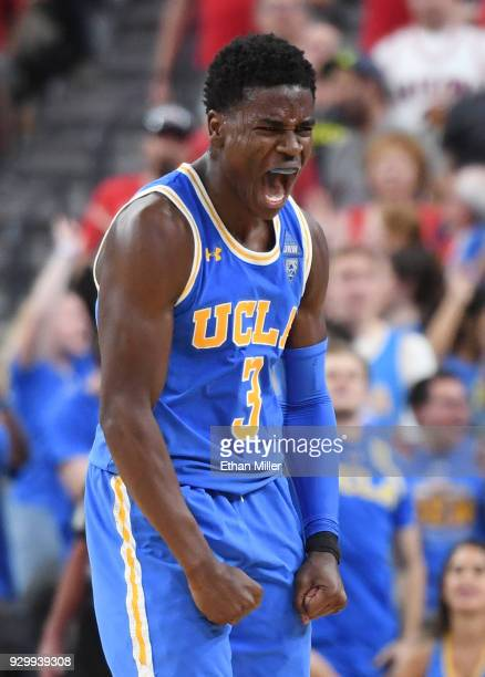 Aaron Holiday of the UCLA Bruins reacts after hitting a 3-pointer against the Arizona Wildcats during a semifinal game of the Pac-12 basketball...