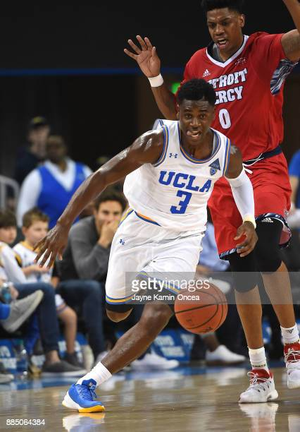 Aaron Holiday of the UCLA Bruins steals the ball from Kameron Chatman of the Detroit Mercy Titans and heads down court in the second half of the game...