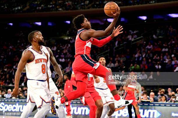 Aaron Holiday of the Washington Wizards attempts a layup against the New York Knicks during a preseason game at Madison Square Garden on October 15,...