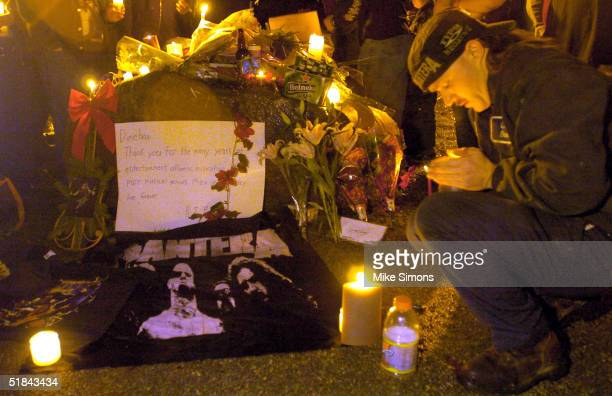 Aaron Holloway lights a candle at a makeshift memorial outside of the Alrosa Villa Club on December 9, 2004 in Columbus, Ohio. According to...