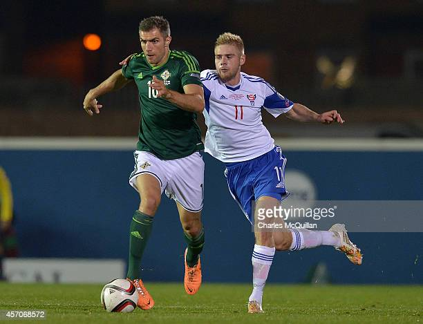 Aaron Hughes and Pall Klettskard during the Euro 2016 Qualifier between Northern Ireland and Faroe Islands at Windsor Park on October 11 2014 in...