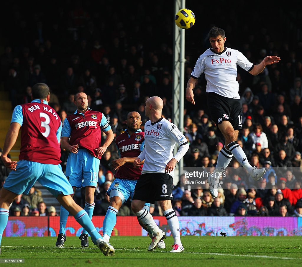 Aaron Hughes of Fulham scores their first goal with a header during the Barclays Premier League match between Fulham and West Ham United at Craven Cottage on December 26, 2010 in London, England.