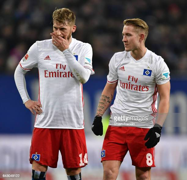 Aaron Hunt and Lewis Holtby of Hamburg discuss during the Bundesliga match between Hamburger SV and SC Freiburg at Volksparkstadion on February 18...