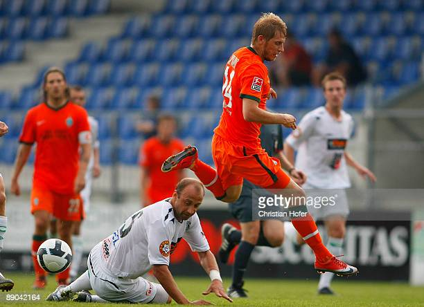 Aaron Hunt and Pavel Drsek fight for the ball during the pre-season friendly match between FK Jablonec 97 and SV Werder Bremen on July 15, 2009 in...