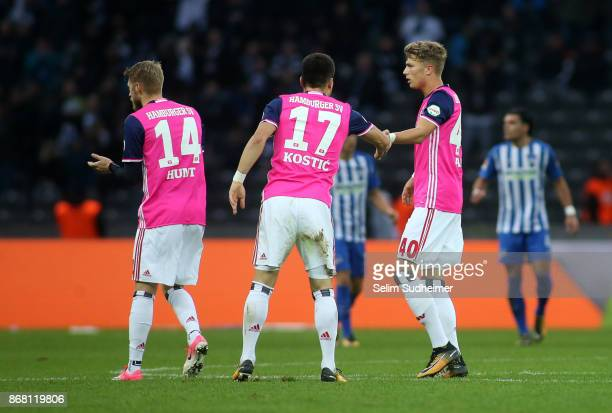 Aaron Hunt Filip Kostic and JannFiete Arp of Hamburger SV celebrates their teams first goal scoring during the Bundesliga match between Hertha BSC...