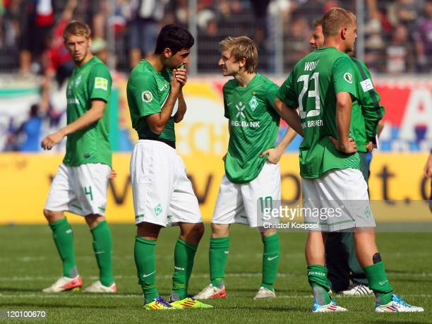 Aaron Hunt Mehmet Ekici Marko Marin and Andreas Wolf of Bremen look dejected after losing 12 the first round DFB Cup match between 1 FC Heidenheim...