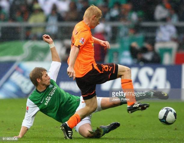 Aaron Hunt of Bremen and Andreas Ibertsberger of Hoffenheim battle for the ball during the Bundesliga match between SV Werder Bremen and 1899...