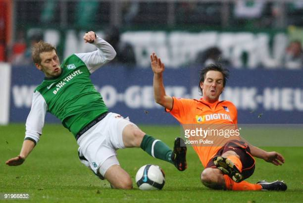 Aaron Hunt of Bremen and Christian Eichner of Hoffenheim battle for the ball during the Bundesliga match between SV Werder Bremen and 1899 Hoffenheim...
