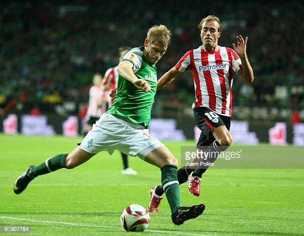 Aaron Hunt of Bremen and Francisco Yeste of Bilbao battle for the ball during the UEFA Europa League Group L match between SV Werder Bremen and...