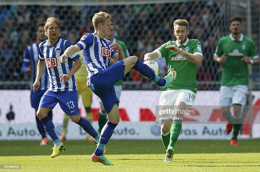 Aaron Hunt (R) of Bremen and Johannes van den Bergh of Berlin compete for the ball during the Bundesliga match between Werder Bremen and Hertha BSC at Weserstadion on May 3, 2014 in Bremen, Germany.