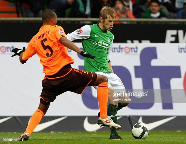 Aaron Hunt of Bremen and Marvin Compper of Hoffenheim battle for the ball during the Bundesliga match between SV Werder Bremen and 1899 Hoffenheim at...