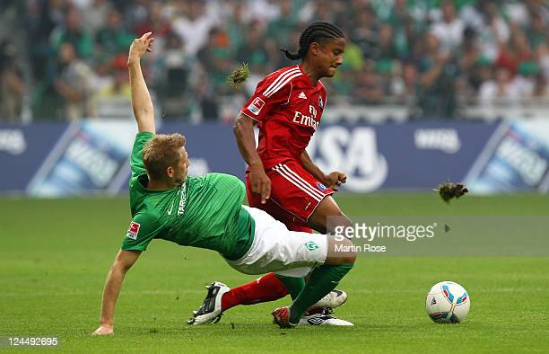 Aaron Hunt of Bremen and Michael Macienne of Hamburg battle for the ball during the Bundesliga match between Werder Bremen and Hamburger SV at Weser...