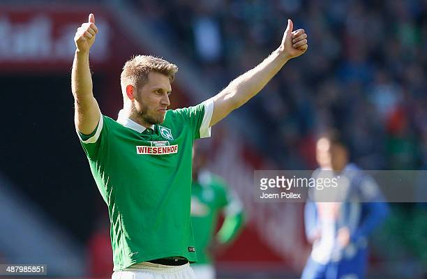Aaron Hunt of Bremen celebrates after he scored his team's second goall during the Bundesliga match between Werder Bremen and Hertha BSC at...