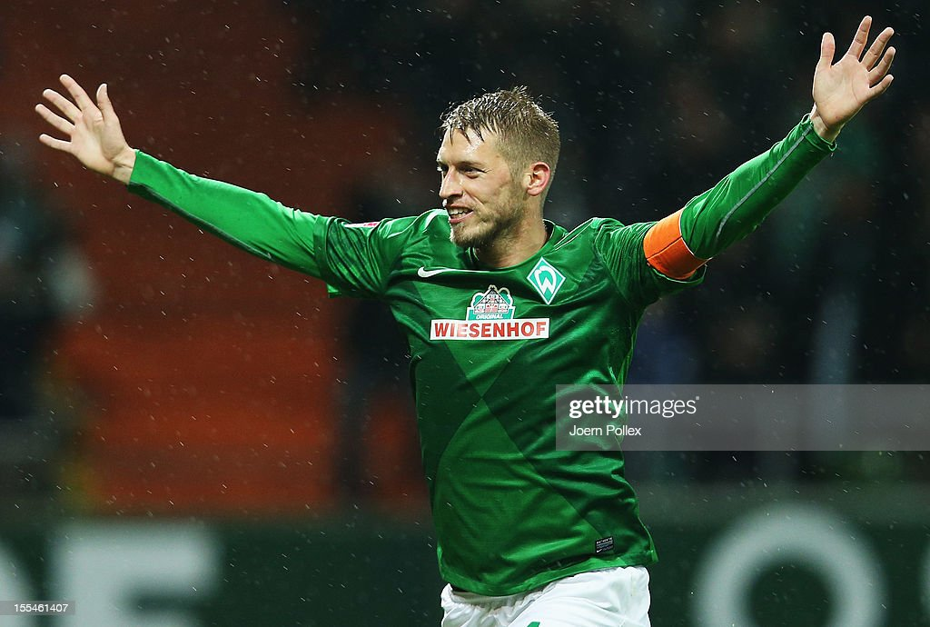 Aaron Hunt of Bremen celebrates after scoring his team's first goal during the Bundesliga match between SV Werder Bremen and 1. FSV Mainz 05 at Weser Stadium on November 4, 2012 in Bremen, Germany.