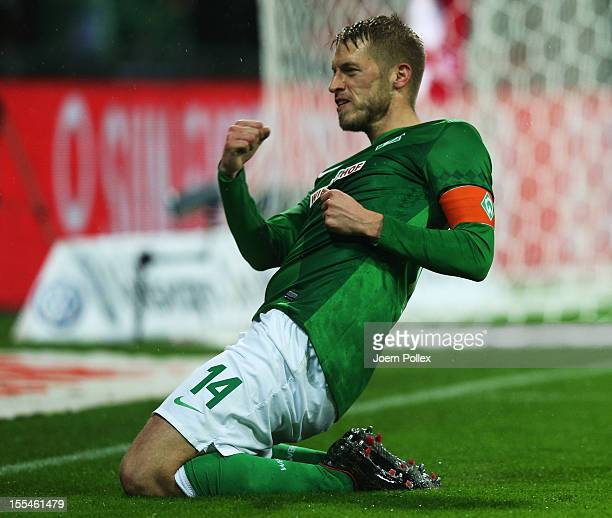 Aaron Hunt of Bremen celebrates after scoring his team's first goal during the Bundesliga match between SV Werder Bremen and 1 FSV Mainz 05 at Weser...
