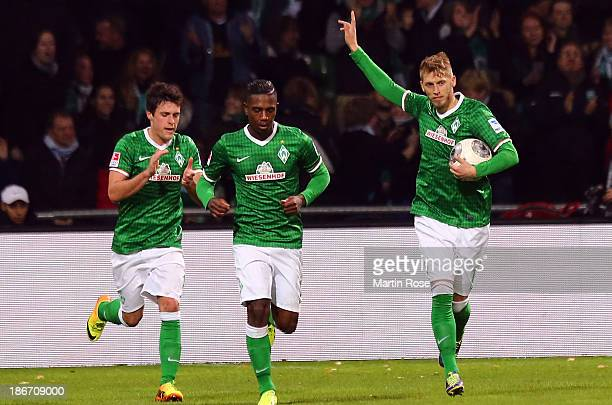 Aaron Hunt of Bremen celebrates after scoring his tem's 1st goal during the Bundesliga match between SV Werder Bremen and Hannover 96 at Weserstadion...