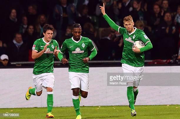 Aaron Hunt of Bremen celebrates after scoring his tem's 1st goal during the Bundesliga match between SV Werder Bremen and Hannover 96 at Weserstadion...