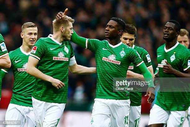 Aaron Hunt of Bremen celebrates after scoring their first goal during the Bundesliga match between Werder Bremen and Hamburger SV at Weserstadion on...
